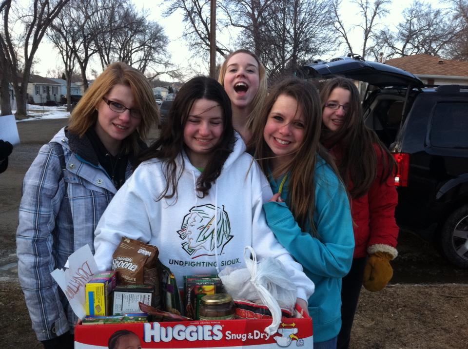 In March, we had the first Welcome House Canned Good Night.  Students collected canned goods.