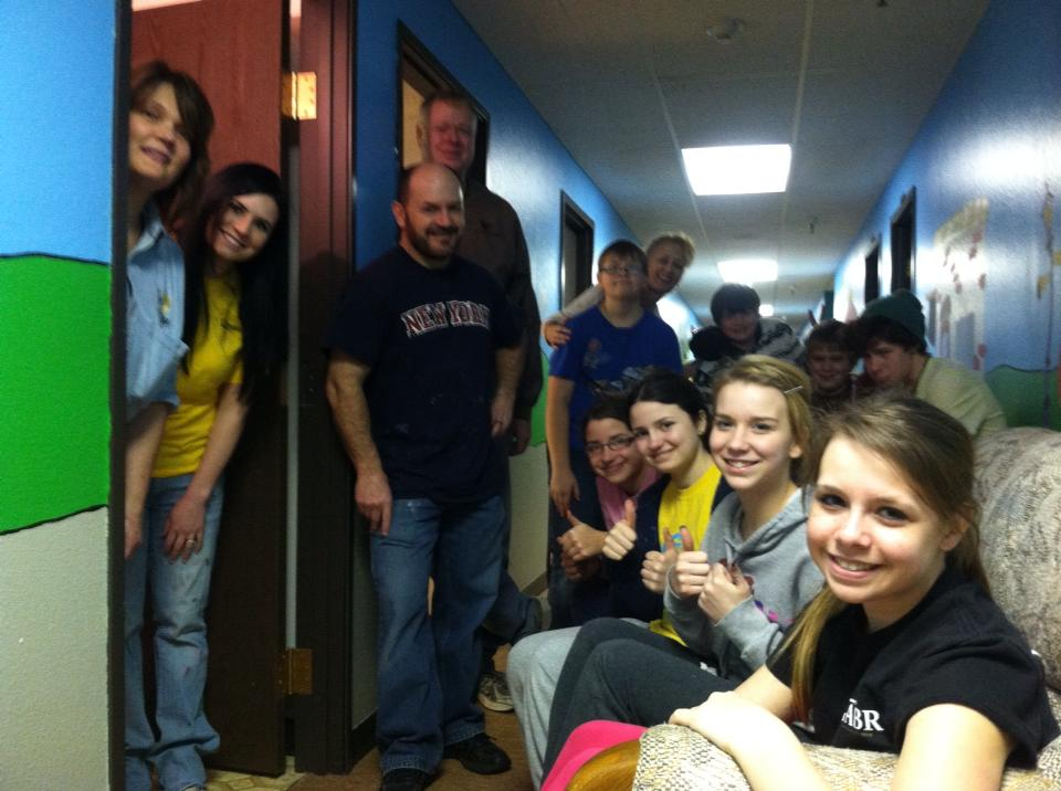 Middle School Students and leaders renovating the SPARK room
