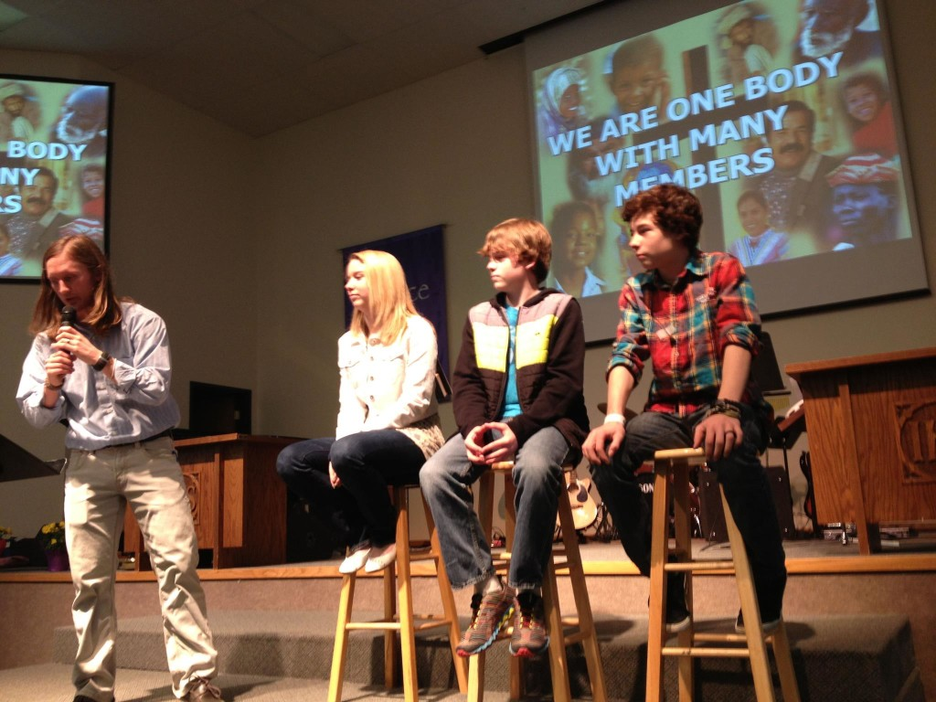 Jim interviewing students for Student Sunday